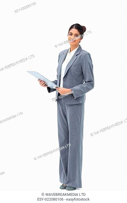 Smiling saleswoman with clipboard