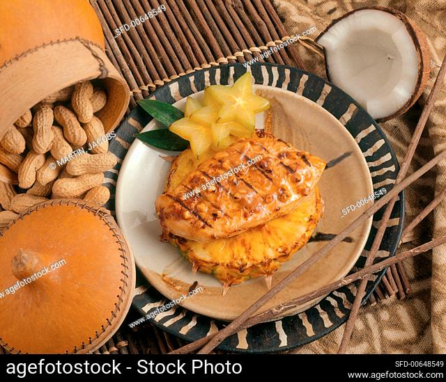 Grilled Chicken Breast in Peanut Sauce on Pineapple