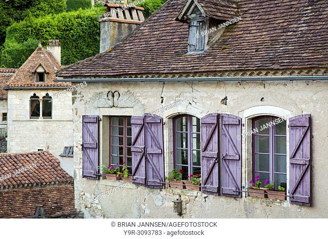 Blue shutters on home in Saint-Cirq-Lapopie, Midi-Pyrenees, France