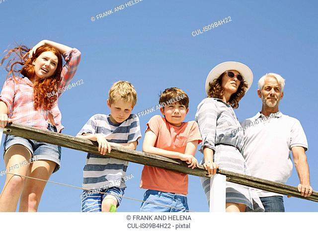 Low angle view of family on houseboat looking away, Kraalbaai, South Africa