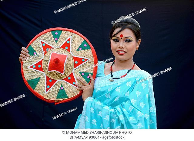 Woman holding japi, india, asia, mr#786