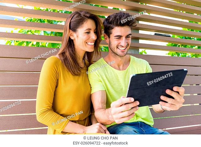 Caucasian couple use of the digital table pc