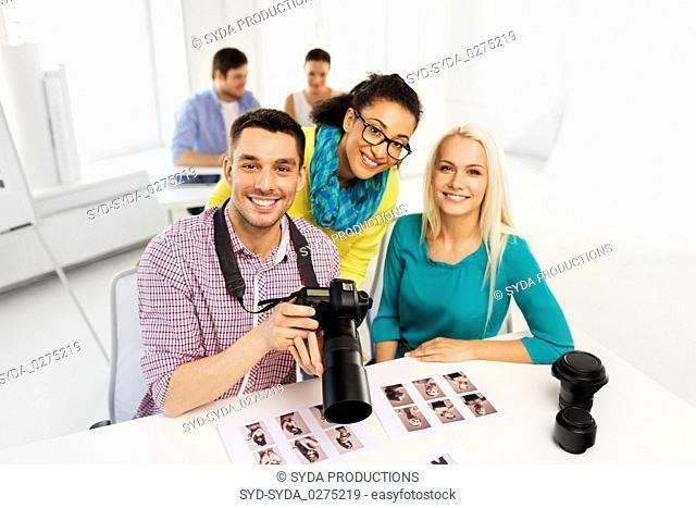 photographers with camera at photo studio
