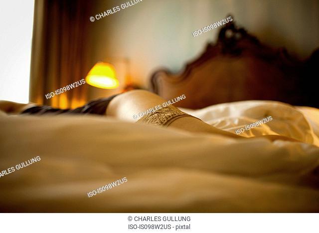 Woman lying on bed wearing underwear