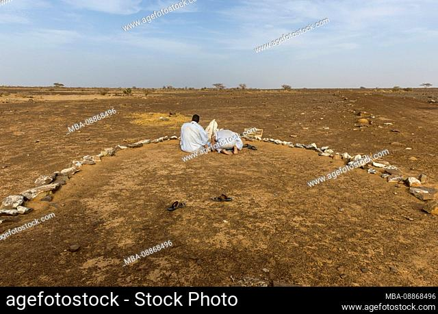Afternoon praying time in the Adrar, Mauritania