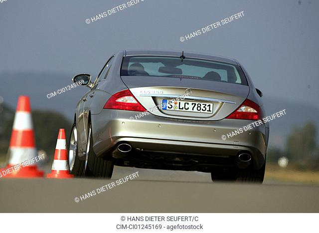 Car, Mercedes CLS 350, model year 2004-, silver, Limousine, driving, diagonal from the back, rear view, test track, Pilonen