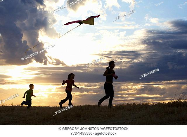 A young boy aims for the sky with his kite