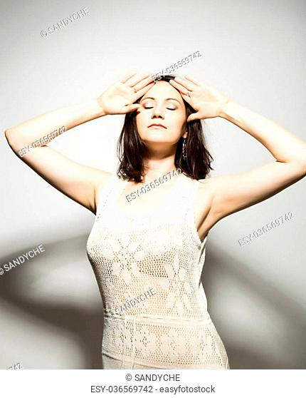 close-up portret of beautiful young brunette woman in a transparent dress posing and expresses different emotions