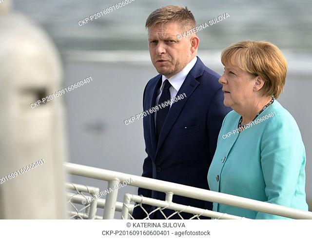 Slovak Prime Minister Robert Fico (left) and German Chancellor Angela Merkel take part in EU summit. Statesmen left for working luncheon on boat on Danube River