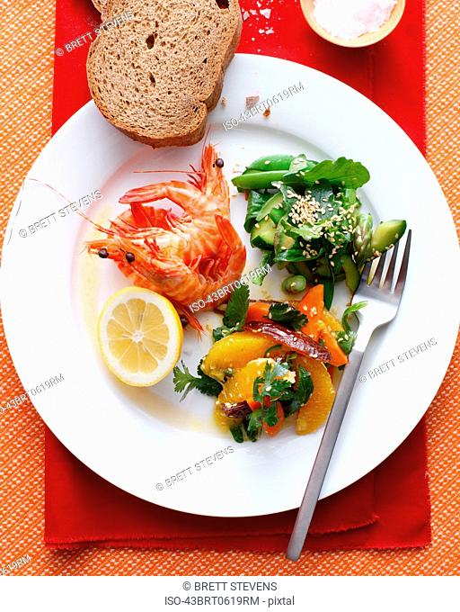 Plate of prawns with salads and bread