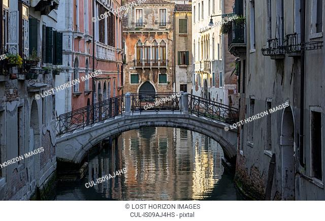 View of bridge and reflection on canal, Venice, Veneto, Italy