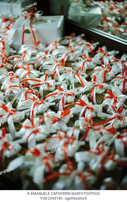 Favors with white and red ribbons