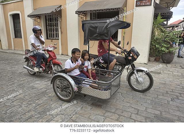 Kids using tricycle transport, Vigan, Ilocos Sur, Philippines