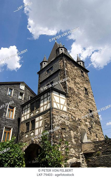 Old half-timbered house and tower in front of blue sky, Bacharach, Rhineland-Palatinate, Germany