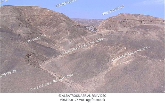 Aerial footage of Dirt road in Negev Desert