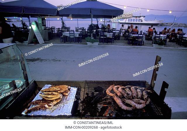 Port, restaurant, fishes and shrimps on barbecue Elafonissos, Lakonia, Peloponnese, Greece