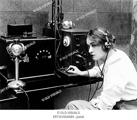 Woman sending Morse code using telegraph All persons depicted are not longer living and no estate exists Supplier warranties that there will be no model release...