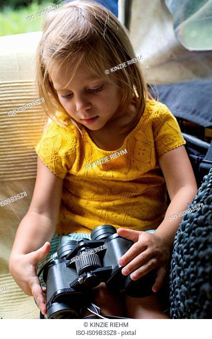 Young girl holding binoculars