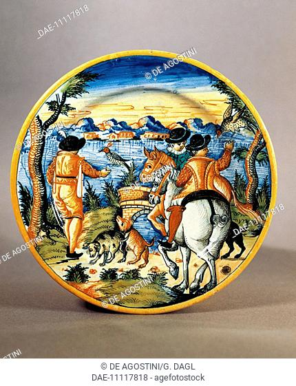 Plate depicting a falcon hunting scene, maiolica, Nevers manufacture, Burgundy. France, 17th century.  Sevres, Musée National De Céramique (Pottery Museum)