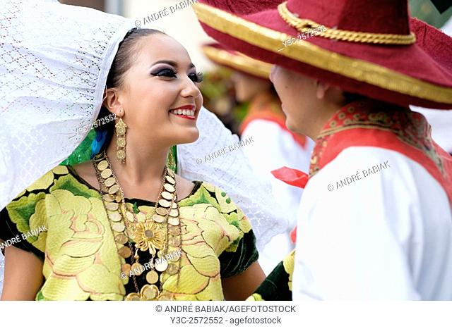 Woman smiling at man. Puerto Vallarta, Jalisco, Mexico. Xiutla Dancers - a folkloristic Mexican dance group in traditional costumes representing the culture and...