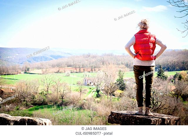 Rear view of woman looking away at elevated view, Bruniquel, France
