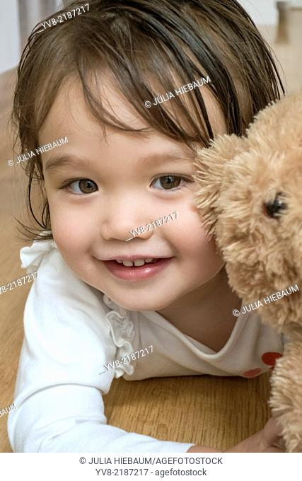 Two year old girl with her teddy bear