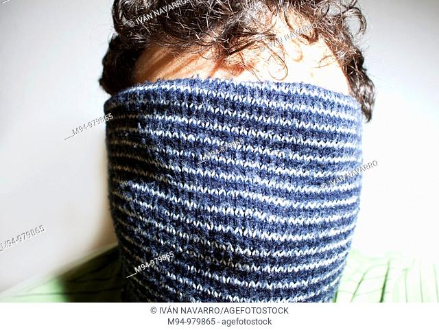 Man with a scarf in his head