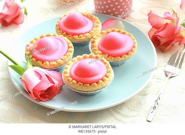 Pink cakes on blue plate
