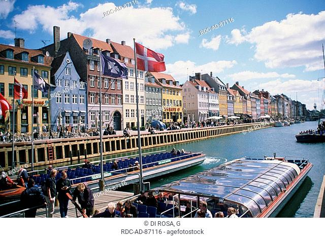 Pleasure steamer in harbour Nyhavn and row of houses Copenhagen Zealand Denmark