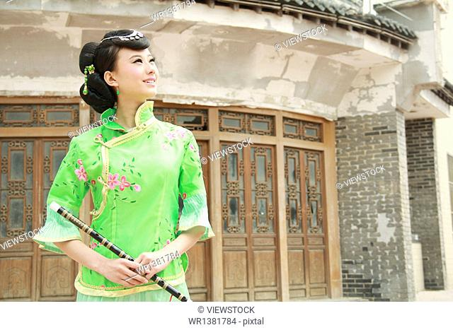 Beauty costume holding a flute