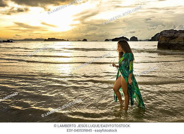 Young girl posses at Ao Nang Beach, Krabi, Thailand
