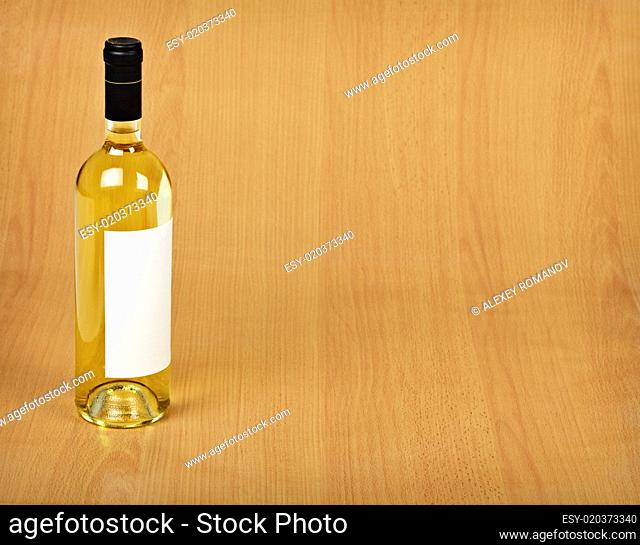 Bottle of white wine on wooden table