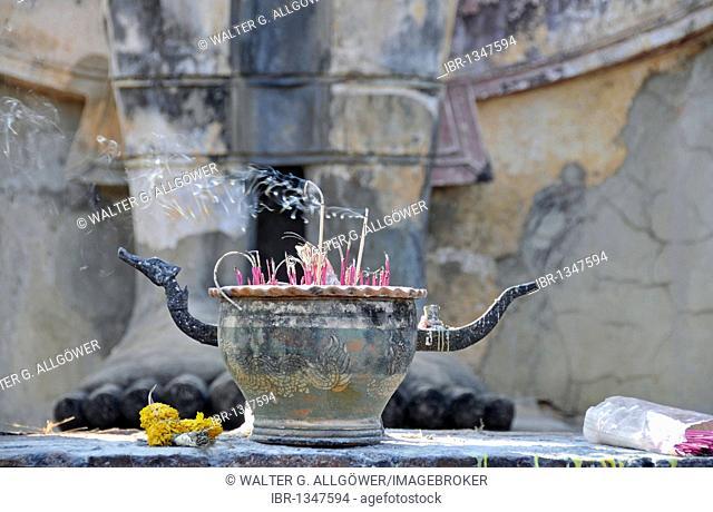 Burning incense in front of a Buddha statue, Wat Saphan Hin, Sukhothai Historical Park, Sukhothai, Thailand, Asia