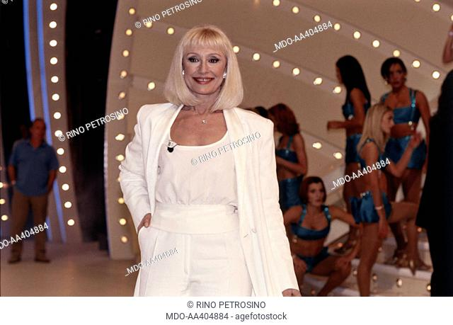Raffaella Carrà wearing a white dress in Carràmba! Che fortuna. Italian TV presenter, actress, singer and showgirl Raffella Carrà (Raffaella Maria Roberta...