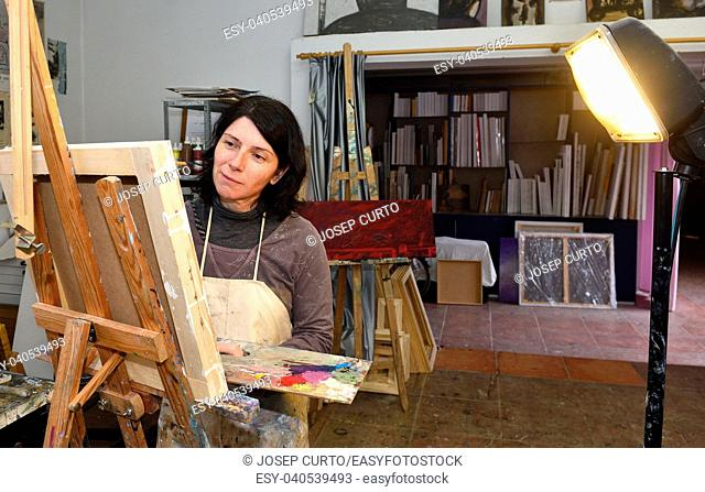 woman painting in a painting studio
