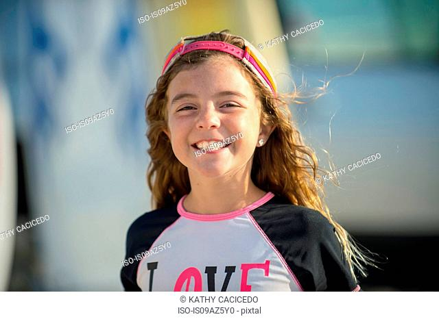 Portrait of young girl at beach, smiling