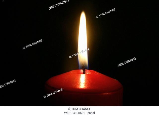 Lit candle, close up