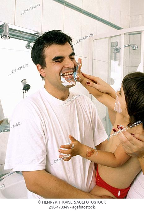 Father with daughter shaving