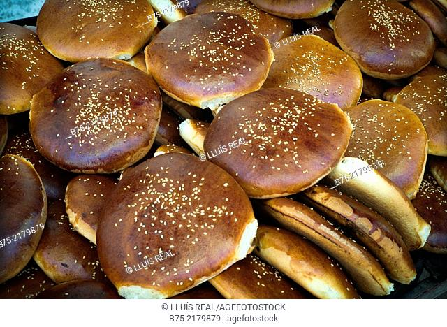 Moroccan typical bread toped with seeds, in a bakery in the Medina of Fez, Morocco, Africa