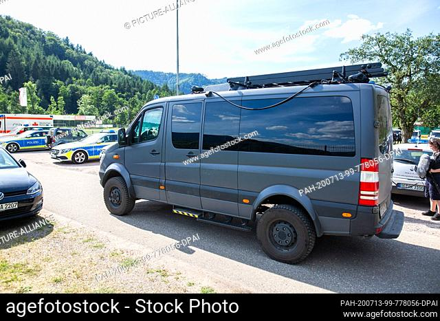 13 July 2020, Baden-Wuerttemberg, Oppenau: A SEK vehicle drives over the parking lot of a sports field, which serves as a meeting point for the police