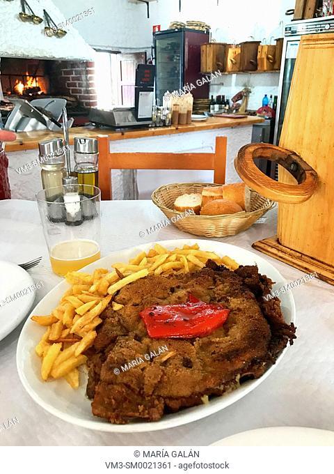 Cachopo serving in a traditional sidreria. La Franca, Asturias, Spain
