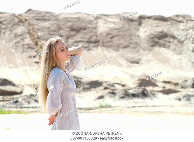Beautiful blond girl in the sunny day