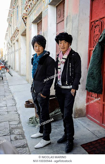 Modern day Tibetan fashionistas, those who have left traditional life and have been absorbed by Chinese fashion. Kham, Tibet