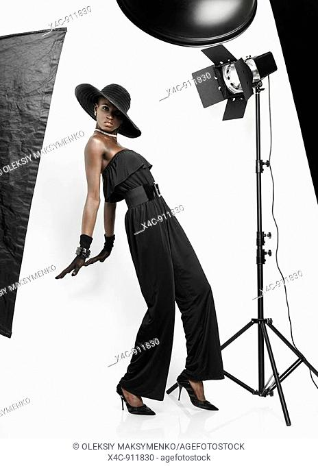 Elegant young feamale fashion model in studio settings during a photo shoot