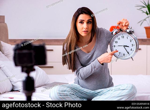 Pregnant woman recording video for her blog