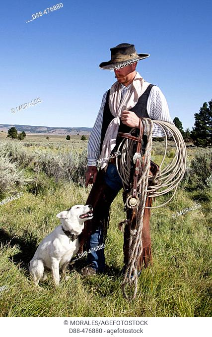 Cattleman with border collie. Ponderosa Ranch. Seneca. Oregon . USA