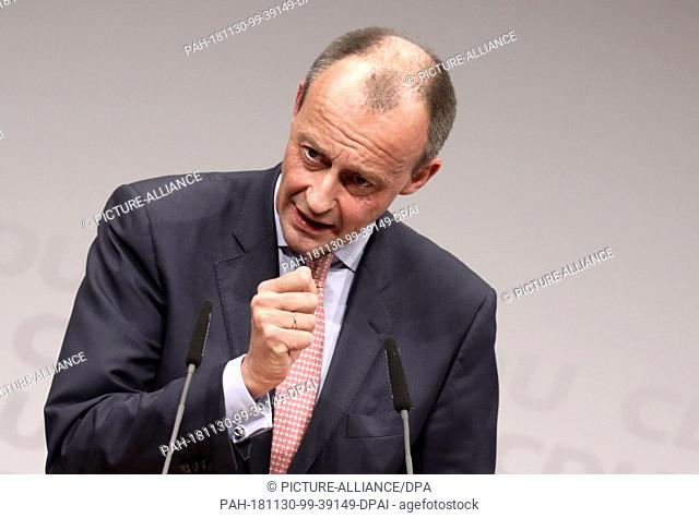 30 November 2018, Berlin: Friedrich Merz (CDU), former head of the CDU/CSU parliamentary group, speaks to party members at the CDU regional conference in...