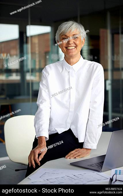 Portrait of relaxed senior businesswoman in her office