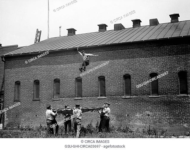 Fireman Jumping from Building Rooftop, Firemen's School, Washington DC, USA, Harris & Ewing, 1921