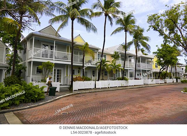 Key West florida is a popular cruise destination where tourists visit shops and quaint old residential neighborhoods
